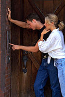 Couple ringing doorbell