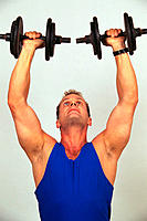 Adult man lifting hand weights