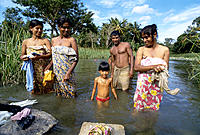 Women washing clothes in the river. Dambulla. Sri Lanka