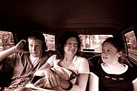 Family riding in a taxi