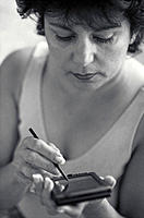 Woman using a Personal Digital Assistant