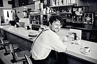 Man sitting at diner counter
