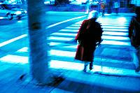 Elderly woman on pedestrian crossing