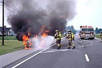 Firemen fighting a car fire
