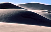 Sand blown by strong winds. Eureka Dunes. Death Valley National Park. California. USA