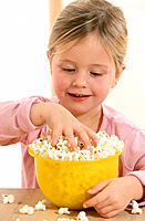 Girl eating popcorns