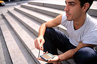 Man using a PDA (Personal digital assistant)