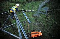 Lineman working on electric tower
