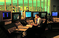 Workers in control room at natural gas fired power plant