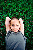 Girl lying on grass