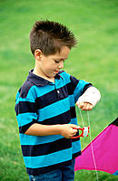 Boy with broken arm, playing with kite
