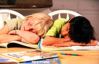 Two young children asleep