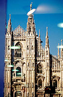 Reflection of Duomo in shop window. Milan. Italy