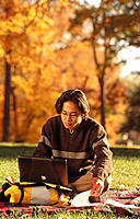 Asian college student with laptop computer