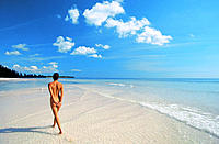Nude woman walking on beach. Bahamas