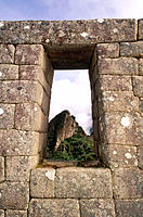 Huayna Picchu viewed through a doorway. Machu Picchu. Peru