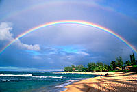 Double rainbow and evening light on Tunnels Beach, North Shore, Island of Kauai, Hawaii