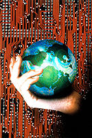 Hand holding earth with circuit board background