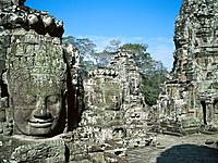 Faces of smiling Buddah statues at temple complex of Angkor Thom. Angkor. Cambodia