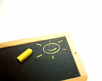 Blackboard with smiling sun