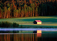 Barn behind lake. Västerbotten. Sweden