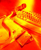 Keyboard, telephone receiver and bills, paying bills on-line & by phone