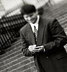 Businessman uses palm pilot