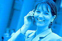 Close-up of smiling businesswoman on cell phone, blue hue