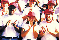 Close-up of crowd wearing white t-shirts and red baseball caps