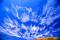 Strato cirrus clouds, dramatic blurred streaks in blue sky A35E