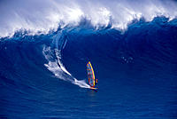Hawaii Maui Jaws windsurfer Sierra Emory in distance riding large wave D1240
