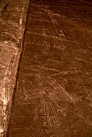 Nazca lines. Aerial photograph of a geoglyph, or landscape drawing, in the coastal desert of southern Peru. This geoglyph (white lines, lower frame) r...