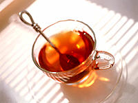 Cup of tea. Tea is an infusion of the leaves of the tea plant (Camellia sinensis). It contains the stimulant caffeine.