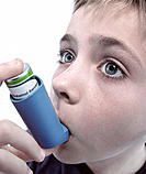 Asthma attack. Boy using an inhaler to treat an asthma attack. Asthma is a lung disorder where attacks of breathlessness, wheezing and coughing are ca...