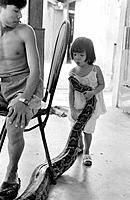 Girl with pet snake. Vietnam