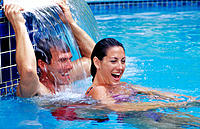 Playful couple in swimming pool