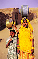 Girls in search of water in the surroundings of Thar Desert. Rajasthan. India