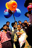 Boy selling balloons at local market, near Khajurajo. India
