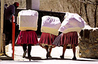 Indian women carrying bundles through the Argentina-Bolivia border