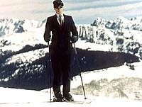 Close-up of a businessman holding ski poles