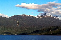 Clouds over a snowcapped mountain, Puyuhuapi Channel, Chile