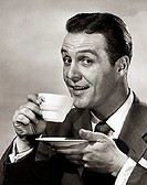 Portrait of a mature man drinking from a coffee cup