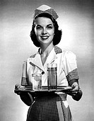Portrait of a waitress holding a tray of drinks