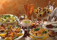 Tuscan New Year´s Eve buffet, with salads, chicken, grissini