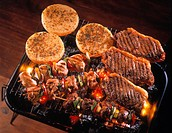 Argentinian steaks, kebabs and provolone on barbecue