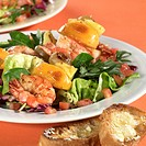 Mixed salad leaves with shrimps and fruit