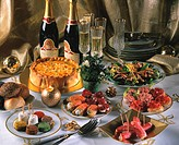 New Year´s Eve buffet with snacks, salad, cake and champagne