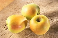 Three Golden Delicious apples