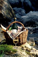 A bottle of Sancerre in a basket and wine glasses (1)