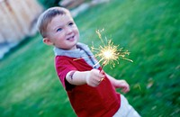 Boy (2 yr) playing with a sparkler. Boise. Idaho. USA